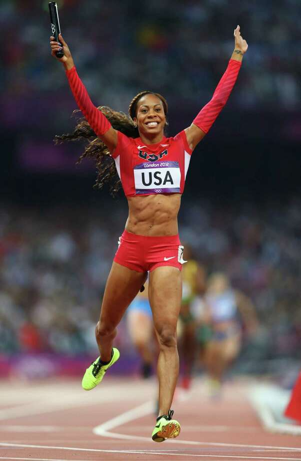 Sanya Richards-Ross of the United States celebrates as she crosses the finish line to win gold in the women's 4 x 400m relay Saturday. Photo: Michael Steele, Getty / 2012 Getty Images