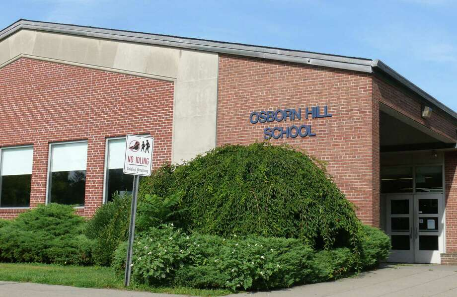 Testing for elevated PCB levels at Osborn Hill School continues, though school officials hope to have the school clean and ready to open for the new school year. Photo: Genevieve Reilly / Fairfield Citizen