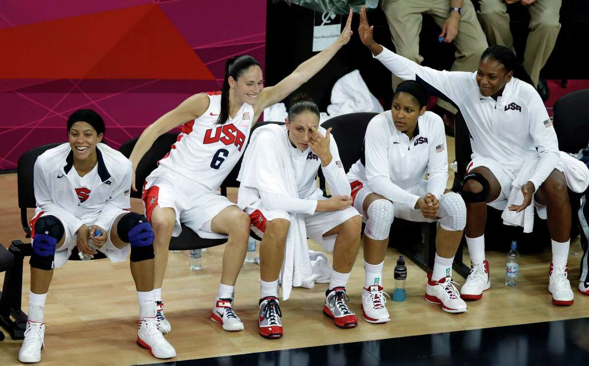 US players react on the bench during a women's gold medal basketball game against France on Saturday. The U.S. won 86-50 and won the gold medal for the fifth straight Olympics,  (AP Photo/Victor R. Caivano)