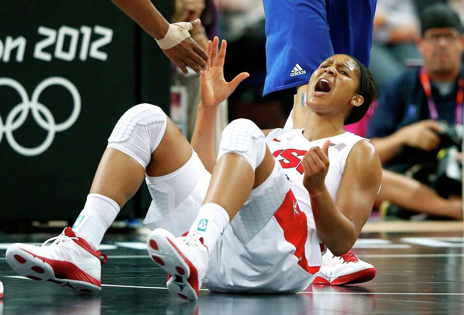 Maya Moore  of United States reacts after being fouled in the second half against France during the gold-medal basketball game. The US won 86-50 (Poto by Jamie Squire/Getty Images) Photo: Jamie Squire, Ap/getty / 2012 Getty Images
