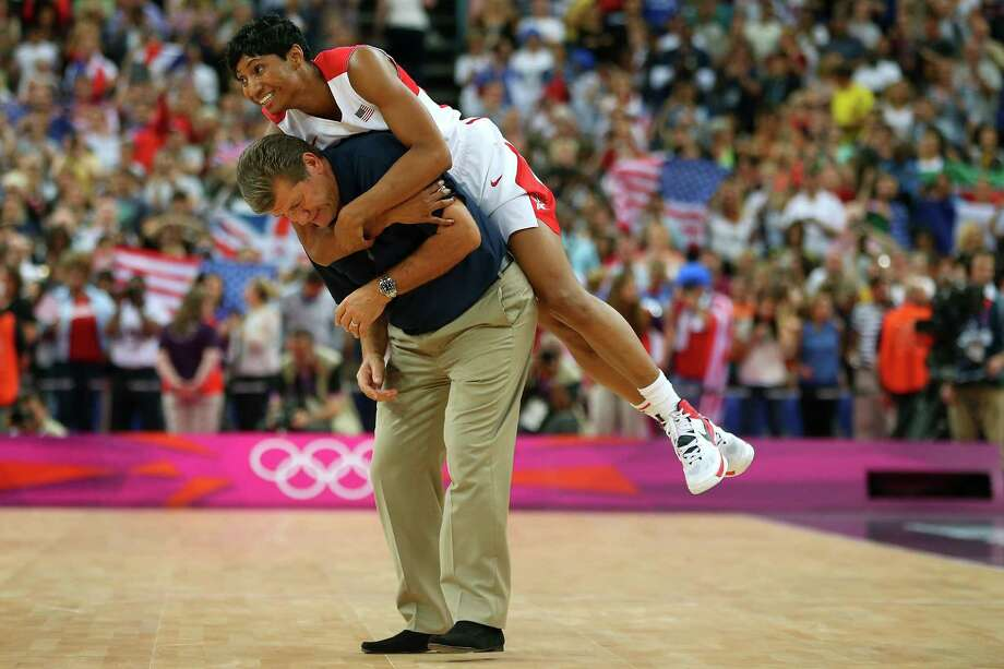 Angel McCaughtry jumps on the back of head coach Geno Auriemma after the United States defeated France 86-50 to win the gold medal on Saturday.  (Photo by Phil Walter/Getty Images) Photo: Phil Walter, Ap/getty / 2012 Getty Images