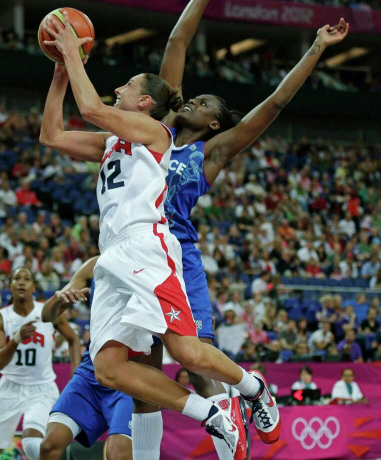 Diana Taurasi drives to the basket against France's Jennifer Digbeu on Saturday. (AP Photo/Charles Krupa) Photo: Ap/getty
