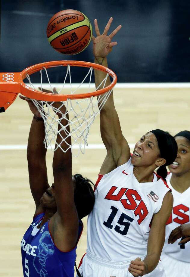 United States' Candace Parker goes high over France's Endene Miyem on Saturday. (AP Photo/Victor R. Caivano) Photo: Ap/getty
