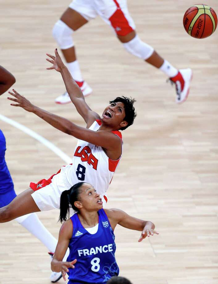 United States' Angel McCoughtry loses the ball against France's Edwige Lawson-Wade. (AP Photo/Julio Cortez) Photo: Ap/getty