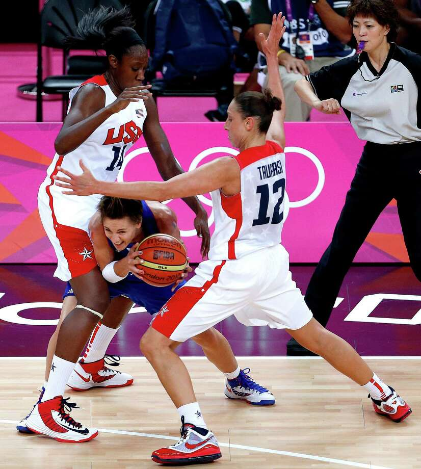 France's Celine Dumerc, center, is double teamed by the United States' Tina Charles, left, and Diana Taurasi . (AP Photo/Julio Cortez) Photo: Ap/getty