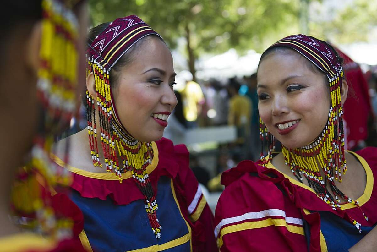 Janice Cruz, left, and Catherine Centeno, right, with the Filipino Folk Ensemble, preparefor a performance during the Pistahan Festival, a celebration of Filipino culture, art, dance, music, and food, at Yerba Buena Gardens in San Francisco, Saturday, August 11, 2012.