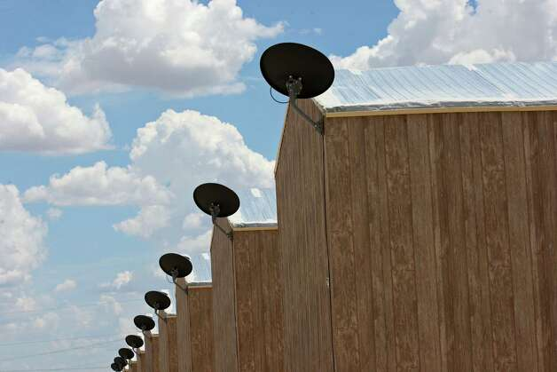 Satellite dishes are used on trailer homes at the Black Gold RV Park in Big Lake, Texas, Thursday, July 26, 2012. The trailers each house up to six workers. With the drilling boom in the area, a man-camp has opened just north of the town. Photo: Jerry Lara, San Antonio Express-News / © 2012 San Antonio Express-News