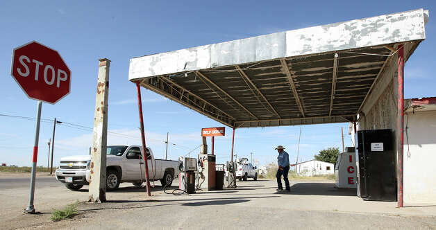 "A customer leaves the only business in Loving County, Texas, Wednesday, July 25, 2012. Located in Mentone, Texas 130 miles west of Midland, the convenience store serves locals and oil field workers. ""Every day around 4:30, it's beer-thirty,"" says store worker, Caren Calloway. Photo: Jerry Lara, San Antonio Express-News / © 2012 San Antonio Express-News"