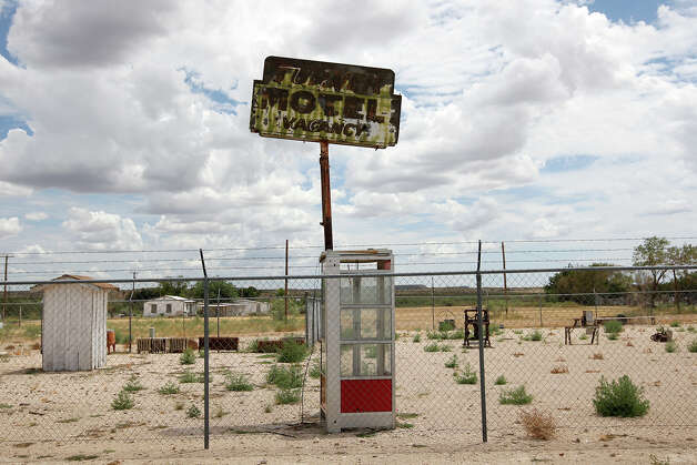 An old motel sign and telephone booth are on display at a museum in Rankin, Texas, Thursday, July 26, 2012. Located 55 miles south of Midland, it is near Santa Rita No. The well started producing oil in 1923 funding the University of Texas and later Texas A&M. Photo: Jerry Lara, San Antonio Express-News / © 2012 San Antonio Express-News