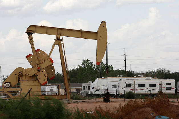 An RV park is located near a pump jack in Midland, Texas, Wednesday, July 25, 2012. The oil and gas boom in the Permian Basin has driven up demand for housing and services. Photo: Jerry Lara, San Antonio Express-News / © 2012 San Antonio Express-News