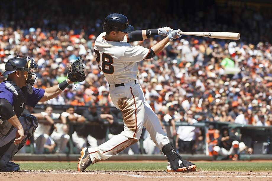 Buster Posey belts a two-run homer to center off Drew Pomeranz in the third inning to give the Giants a 4-0 lead. Photo: Jason O. Watson, Getty Images
