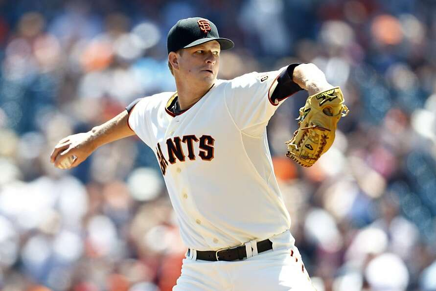 SAN FRANCISCO, CA - AUGUST 11: Matt Cain #18 of the San Francisco Giants pitches against the Colorad