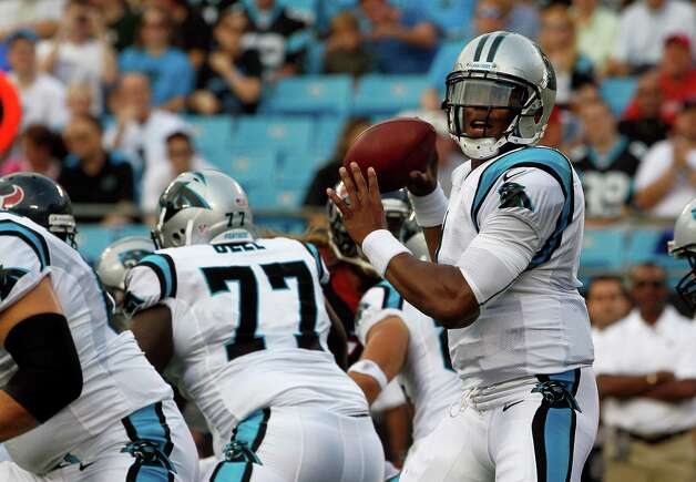 Carolina Panthers quarterback Cam Newton looks to pass against the  Houston Texans in Charlotte, N.C., Saturday, Aug. 11, 2012. (AP Photo/Gerry Broome) Photo: Gerry Broome, Associated Press / AP
