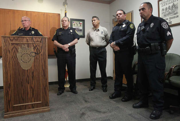 Bexar County Sheriff Amadeo Ortiz (left, at lectern) pauses while speaking to the media Monday August 6, 2012 at the Bexar County Sheriff's Office about two police dogs that died of heat exhaustion while in the care of Sheriff's Deputy Steve Benoy. Ortiz said Benoy forgot about the dogs and that the dogs died of heat exhaustion. Ortiz said measures are being taken to insure this doesn't happen again. Benoy is on administrative leave with pay.  John Davenport/©San Antonio Express-News Photo: John Davenport/© San Antonio Ex, San Antonio Express-News / John Davenport/©San Antonio Exp