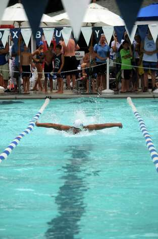 Justo Karell of Innis Arden Blue Fish competes in the Boys 17 and Under 50 SC meter butterfly during the Fairfield County Swim League Championshps at Roxbury Swim and Tennis Club in Stamford on Saturday, August 11, 2012. Photo: Lindsay Niegelberg / Stamford Advocate