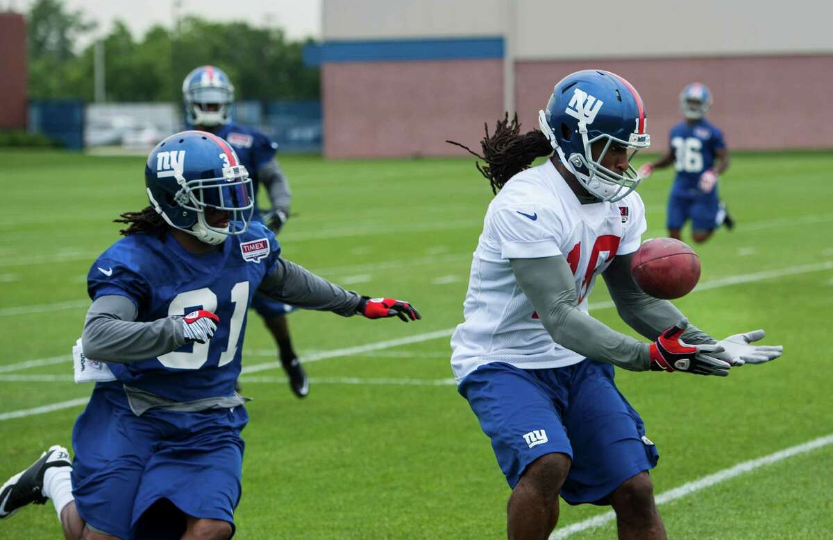 Isaiah Stanback defended by Brandon Bing, New York Giants OTA at the Timex Center. (Corey Sipkin/New York Daily News)