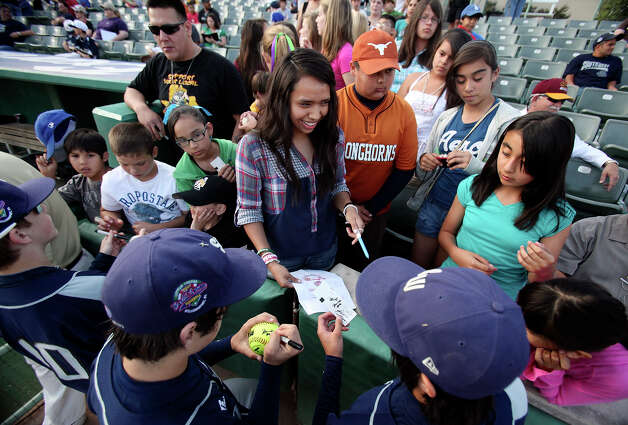 Members of the McAllister Park Little League sign autographs for fans prior to the game with Reynosa, Mexico, Saturday, May 8, 2010 at Nelson Wolff Stadium. The international goodwill game is a rematch of the 2009 LLWS consolation game. Photo: Edward A. Ornelas, San Antonio Express-News / eaornelas@express-news.net