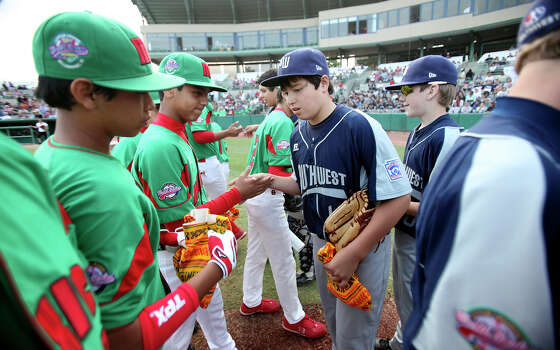 Members of Reynosa, Mexico, and McAllister Park Little League teams exchange gifts prior to the game Saturday, May 8, 2010 at Nelson Wolff Stadium.  The international goodwill game is a rematch of the 2009 LLWS consolation game. Photo: Edward A. Ornelas, San Antonio Express-News / eaornelas@express-news.net