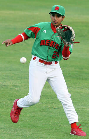 Reynosa, Mexico's Enrique Perez fields a ball hit by McAllister Park's John Shull Saturday, May 8, 2010 at Nelson Wolff Stadium. Shull was safe at first.  The international goodwill game is a rematch of the 2009 LLWS consolation game. Reynosa won 9-8. Photo: Edward A. Ornelas, San Antonio Express-News / eaornelas@express-news.net