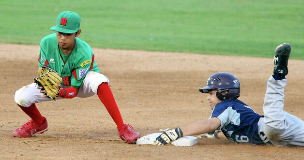 McAllister Park's Nick Smisek slides safely into second base around Mexico's Raul Rojas Saturday, May 8, 2010 at Nelson Wolff Stadium.  The international goodwill game is a rematch of the 2009 LLWS consolation game. Reynosa won 9-8. Photo: Edward A. Ornelas, San Antonio Express-News / eaornelas@express-news.net