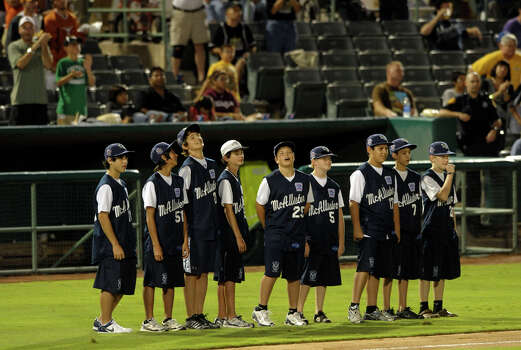 The McAllister Park Little League team which made it to the Little League World Series is greeted with cheers after being introduced during the Texas League playoffs game between the Midland Rockhounds and the San Antonio Missions at Nelson Wolff Stadium on Thursday, Sept. 10, 2009. Photo: Billy Calzada, San Antonio Express-News / gcalzada@express-news.net