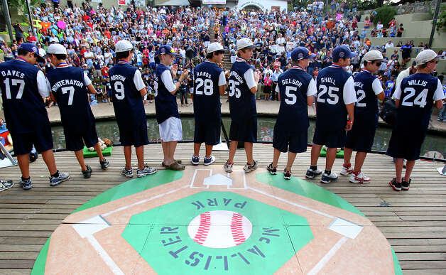 Members of the McAllister Park Little League All-Stars are introduced to the crowd in the Arneson River Theater during the river parade celebration Sunday, Sept. 6, 2009. Photo: Edward A. Ornelas, San Antonio Express-News / eaornelas@express-news.net