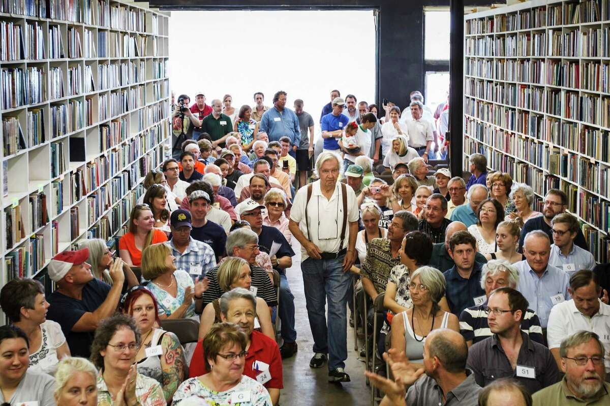 """Larry McMurtry, the famed Texas novelist, screenwriter and bookseller, who won a Pulitzer Prize for his book """"Lonesome Dove"""", walks to the front of his bookstore Booked Up No. 4 to address the crowd before auctioning off more than 300,000 books at """"The Last Book Sale,"""" Friday, Aug. 10, 2012, in Archer City."""