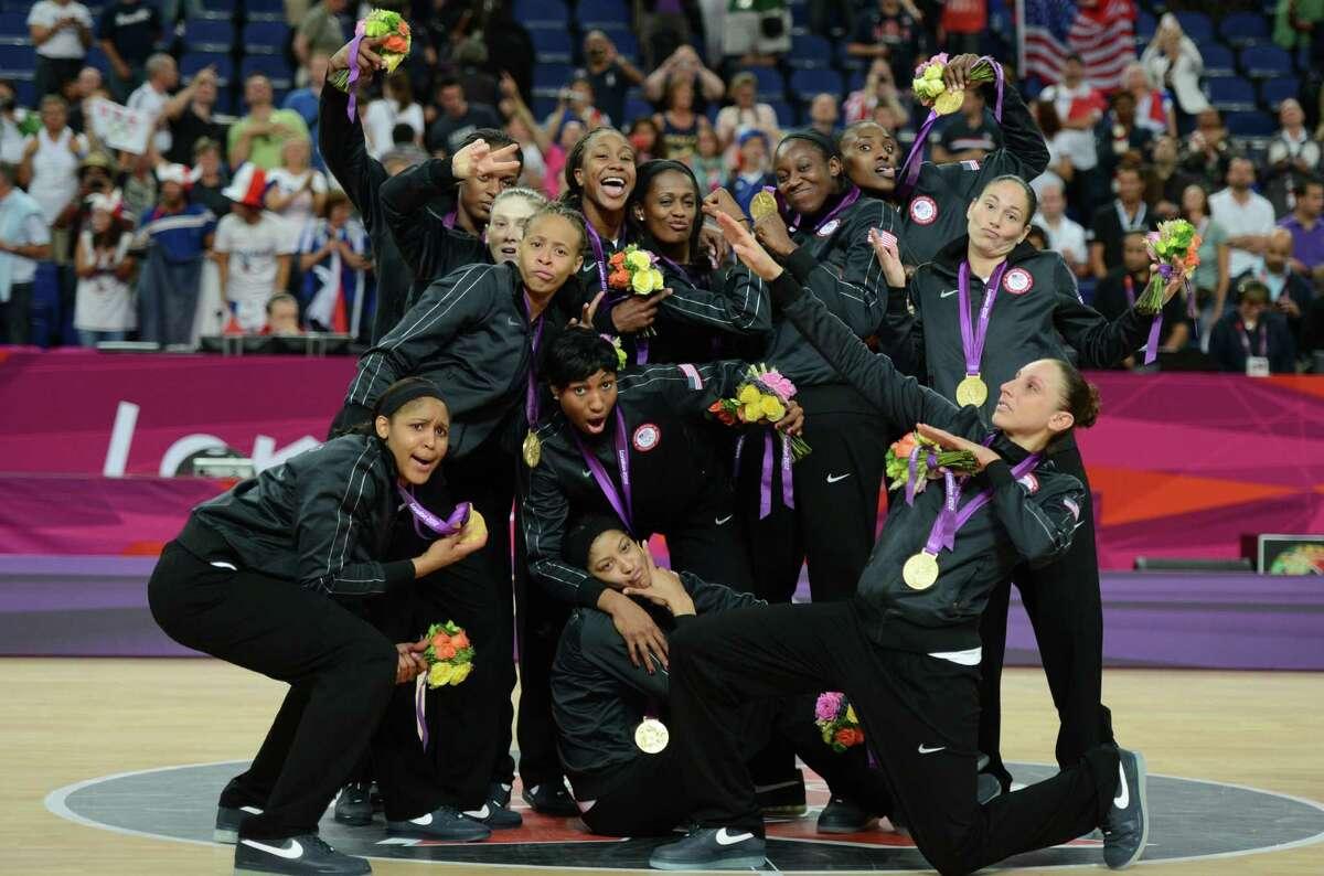 US players strike a pose Saturday.
