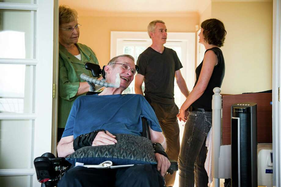 Dr. Richard Wesley, second from left, who has Lou Gehrig's disease, lives with his family in Seattle. He appreciates Washington's Death With Dignity Act. Photo: LEAH NASH / NYTNS