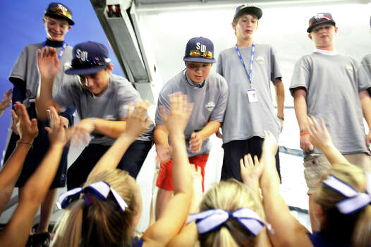 Members of the McAllister Park Little League team celebrate with MacArthur High School cheerleaders during the welcome home celebration held Monday, Aug. 31, 2009 at the San Antonio International Airport. Photo: Jennifer Whitney, San Antonio Express-News File Photo / jwhitney@express-news.net