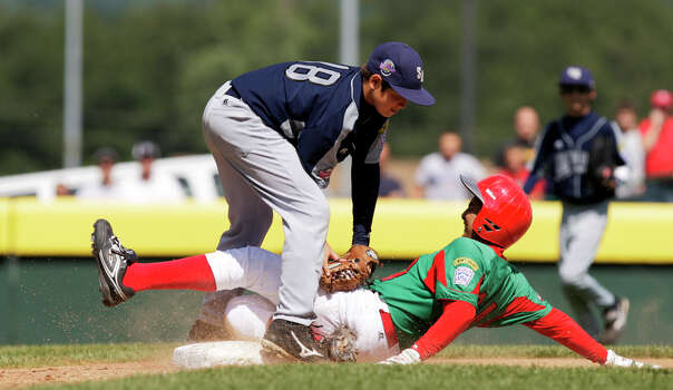 Reynosa, Mexico's Luis Perez slides safely into third as McAllister Park Little League's John Shull attempts a tag in the Consolation Game of the 2009 Little League World Series on Sunday, Aug. 30, 2009 in South Williamsport, Pa. Mexico won 5-4. Photo: Jerry Lara, San Antonio Express-News / glara@express-news.net