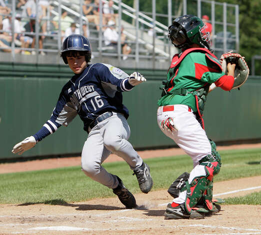 McAllister Park Little League right fielder Jacob Ramos scores during the Consolation Game of the 2009 Little League World Series on Sunday, Aug. 30, 2009 in South Williamsport, Pa. McAllister lost to Reynosa, Mexico, 5-4. Photo: Jerry Lara, San Antonio Express-News / glara@express-news.net