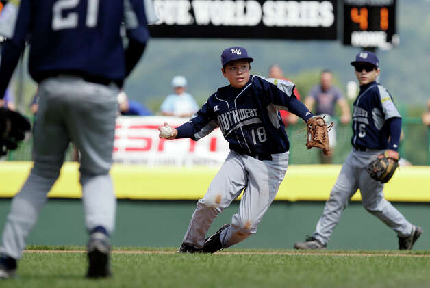 McAllister Park Little League third baseman John Shull throws to first after catching a grounder from Reynosa, Mexico's Oscar Noguera in the Consolation Game of the 2009 Little League World Series on Sunday, Aug. 30, 2009 in South Williamsport, Pa. Mexico won 5-4. Photo: Jerry Lara, San Antonio Express-News / glara@express-news.net