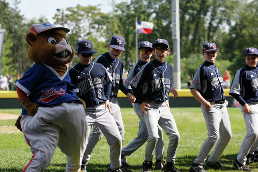 McAllister Park Little League team dances with Dugout before their game against Reynosa, Mexico, in the Consolation Game of the 2009 Little League World Series on Sunday, Aug. 30, 2009 in South Williamsport, Pa. Photo: Jerry Lara, San Antonio Express-News / glara@express-news.net