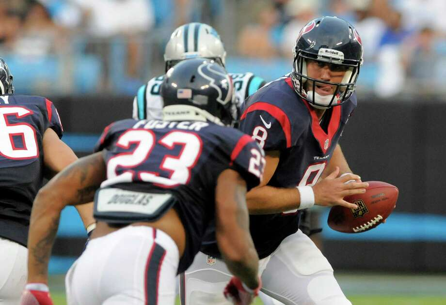 Arian Foster (23), Matt Schaub (right) and the Texans take on the Indianapolis Colts today in Houston.Mike McCarn/Associated Press Photo: Mike McCarn, Associated Press / FR34342 AP