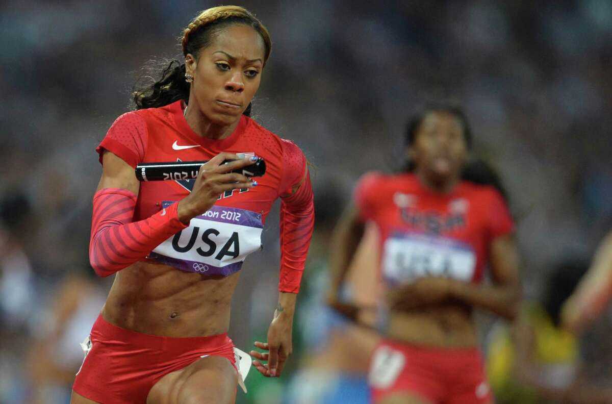 US' Sanya Richards-Ross competes in the women's 4X400 relay final at the athletics event of the London 2012 Olympic Games on August 11, 2012 in London. AFP PHOTO / ERIC FEFERBERGERIC FEFERBERG/AFP/GettyImages