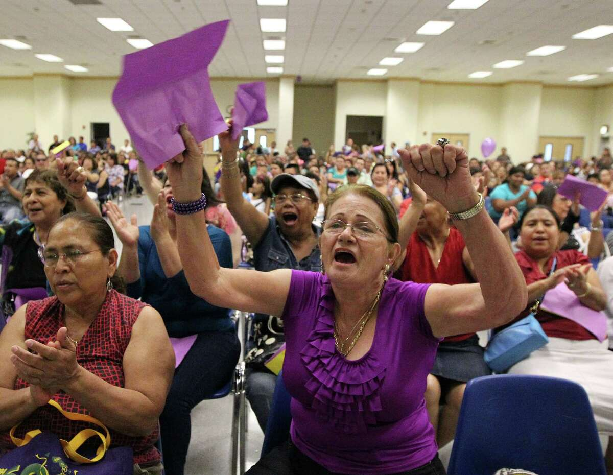 SEIU (Service Employees International Union) member SIxta Gonzalez celebrates after union members ratified a new four-year contract. It will gradually raise wages from $8.35 to $9.35 an hour for most workers.