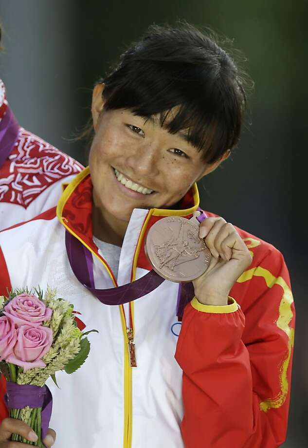Qieyang Shenjie was the first Tibetan to be entered by China in an Olympic event. Photo: Lefteris Pitarakis, Associated Press