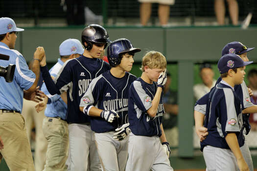 McAllister Park Little League players react after losing to Chula Vista, Calif., 12-2, in the U.S. Championship game of the 2009 Little League World Series on Saturday, Aug. 29, 2009 in South Williamsport, Pa. Photo: Jerry Lara, San Antonio Express-News / glara@express-news.net