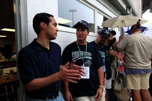 Mayor Julián Castro waits in line with McAllister Park Little League parent Dan Pollard before the start of the U.S. Championship game of the 2009 Little League World Series on Saturday, Aug. 29, 2009 in South Williamsport, Pa. McAllister will play aginst Chula Vista, Calif. Photo: Jerry Lara, San Antonio Express-News / GLARA@EXPRESS-NEWS.NET