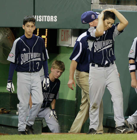 McAllister Park Little League's Troy Montemayor (from left), Wyatt Willis and Travis Daves leave the dugout after their 12-2 loss to Chula Vista, Calif., in the U.S. Championship game of the 2009 Little League World Series on Saturday, Aug. 29, 2009 in South Williamsport, Pa. Photo: Jerry Lara, San Antonio Express-News / glara@express-news.net