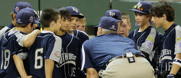 McAllister Park Little League Manager Mike Shull talk to his players after they lost to Chula Vista, Calif., 12-2, in the U.S. Championship game of the 2009 Little League World Series on Saturday, Aug. 29, 2009 in South Williamsport, Pa. Photo: Jerry Lara, San Antonio Express-News / glara@express-news.net