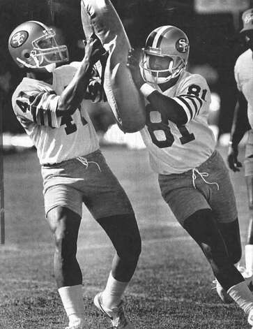 Chandler (right) works out as a 49er with Dokie Williams in 1988.