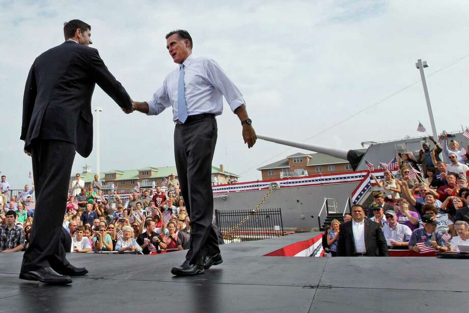 Republican presidential candidate, former Massachusetts Gov. Mitt Romney, right, shakes hands with his newly announced vice presidential running mate, Wisconsin Rep. Paul Ryan, after Ryan  addressed the crowd Saturday, Aug. 11, 2012 in Norfolk, Va.  (AP Photo/Mary Altaffer) Photo: Mary Altaffer