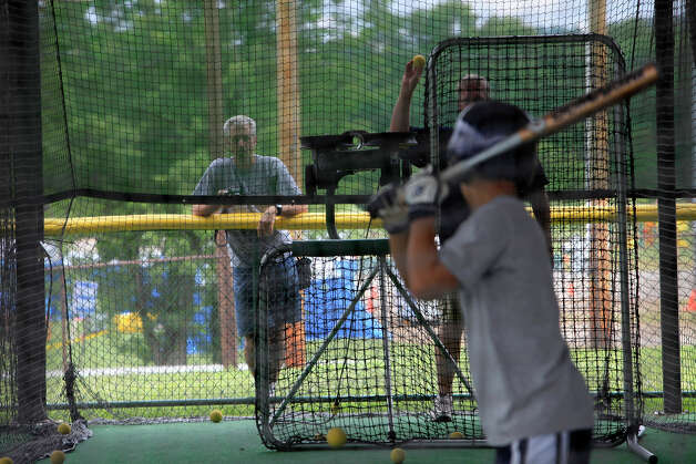 McAllister Park Little League parent Paul Cardone watches batting practice at the International Little League Complex in South Williamsport, Pa., on Thursday, Aug. 27, 2009. Photo: Jerry Lara, San Antonio Express-News / glara@express-news.net