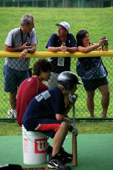 McAllister Park Little League parents Paul Cardone (from left), Kenny Montemayor and Be Shull watch the team at the batting cages, Thursday, Aug. 27, 2009 in South Williamsport, Pa. Photo: Jerry Lara, San Antonio Express-News / glara@express-news.net