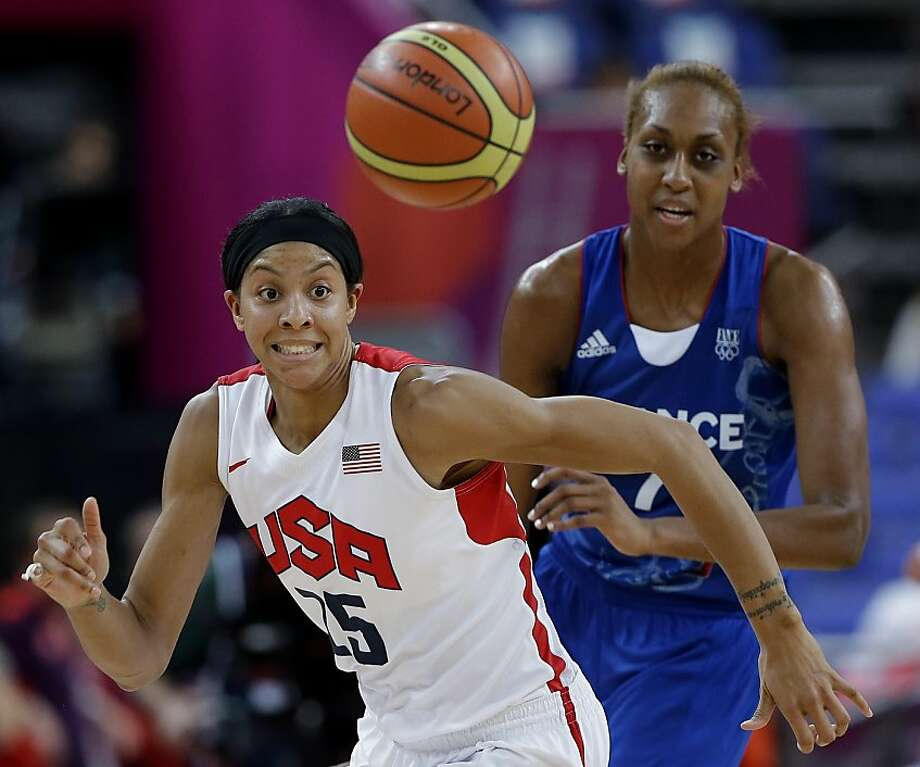 Candace Parker - racing France's Sandrine Gruda for a loose ball - had 21 points and 11 rebounds. Photo: Eric Gay, Associated Press