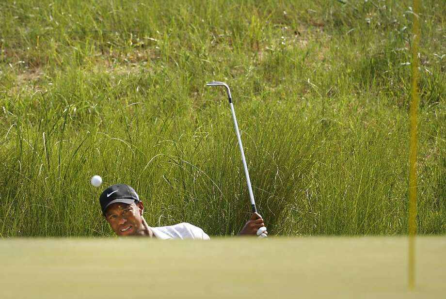 Second-round co-leader Tiger Woods had three bogeys in the seven holes he completed before play was halted. He slipped to a tie for 11th place. Photo: Gerry Melendez, McClatchy-Tribune News Service
