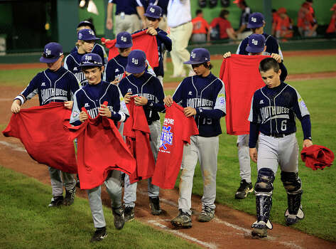 McAllister Park players walk to their dugout after getting shirts from Staten Island, N.Y., after their semifinals at Lamade Stadium in the 2009 Little League Baseball World Series, Wednesday, Aug. 26, 2009 in South Williamsport, Pa. McAllister won 4-1. Photo: Jerry Lara, San Antonio Express-News / glara@express-news.net