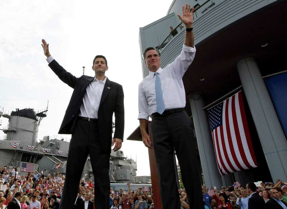 Republican presidential candidate Mitt Romney, introducing Wisconsin Rep. Paul Ryan in Virginia as his choice for running mate, praised Ryan on Saturday before the pair began a campaign swing. Photo: Mary Altaffer / AP